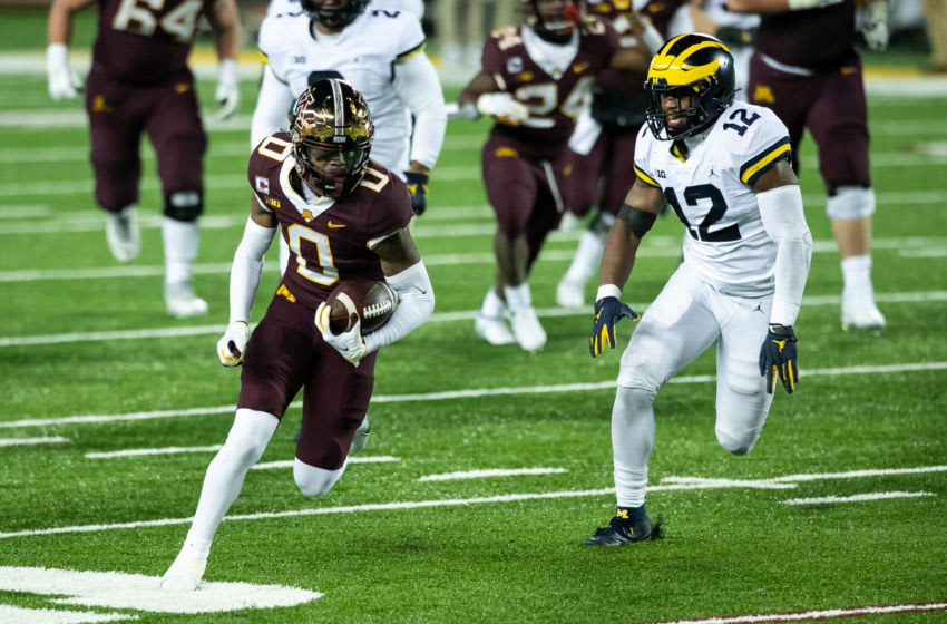 MINNEAPOLIS, MINNESOTA - OCTOBER 24: Rashod Bateman #0 of the Minnesota Golden Gophers carries the ball after catching a pass while Josh Ross #12 of the Michigan Wolverines defends in the third quarter of the game at TCF Bank Stadium on October 24, 2020 in Minneapolis, Minnesota. The Wolverines defeated the Gophers 49-24. (Photo by David Berding/Getty Images)