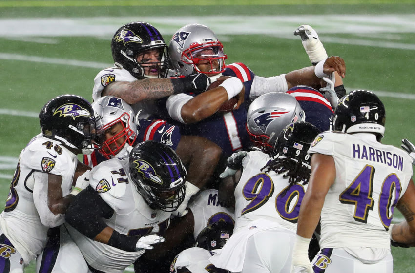 FOXBOROUGH, MASSACHUSETTS - NOVEMBER 15: Cam Newton #1 of the New England Patriots gets the first down on the quarterback keeper against the Baltimore Ravens at Gillette Stadium on November 15, 2020 in Foxborough, Massachusetts. (Photo by Maddie Meyer/Getty Images)