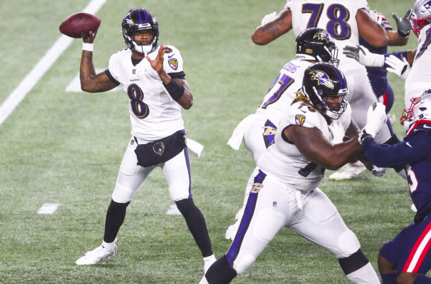 FOXBOROUGH, MASSACHUSETTS - NOVEMBER 15: Lamar Jackson #8 of the Baltimore Ravens throws the ball during a game against the New England Patriots at Gillette Stadium on November 15, 2020 in Foxborough, Massachusetts. (Photo by Adam Glanzman/Getty Images)