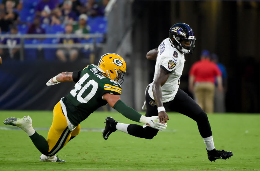 BALTIMORE, MD - AUGUST 15: Lamar Jackson #8 of the Baltimore Ravens runs in front of Curtis Bolton #40 of the Green Bay Packers during the first half of a preseason game at M&T Bank Stadium on August 15, 2019 in Baltimore, Maryland. (Photo by Will Newton/Getty Images)