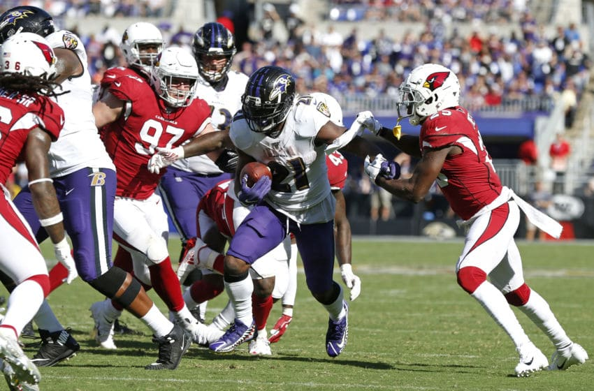 BALTIMORE, MARYLAND - SEPTEMBER 15: Running Back Mark Ingram #21 of the Baltimore Ravens carries the ball against the Arizona Cardinals during the second half at M&T Bank Stadium on September 15, 2019 in Baltimore, Maryland. (Photo by Todd Olszewski/Getty Images)