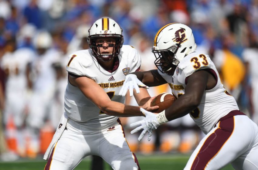 Central Michigan QB Tony Polijan hands off the ball to RB Kumehnnu Gwilly during the University of Kentucky football game against Central Michigan at Kroger Field in Lexington, Kentucky on Saturday, September 1, 2018. 0901ukfbcentralmichweaver10