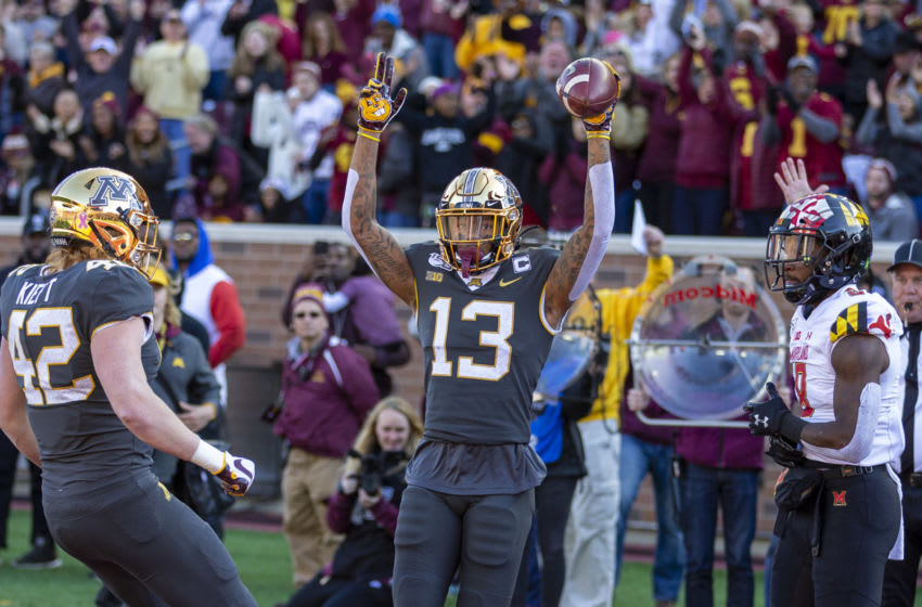 Oct 26, 2019; Minneapolis, MN, USA; Minnesota Golden Gophers wide receiver Rashod Bateman (13) holds his arms up after scoring a touchdown in the first quarter against the Maryland Terrapins at TCF Bank Stadium. Mandatory Credit: Jesse Johnson-USA TODAY Sports