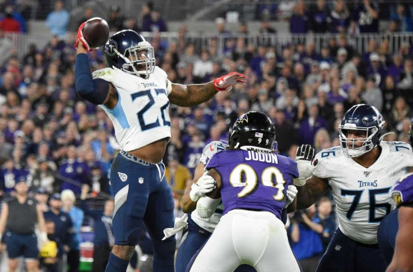 Tennessee Titans running back Derrick Henry (22) passes to wide receiver Corey Davis (84) for a touchdown during the third quarter of an NFL Divisional Playoff game against the Baltimore Ravens at M&T Bank Stadium Saturday, Jan. 11, 2020 in Baltimore, Md. An19137
