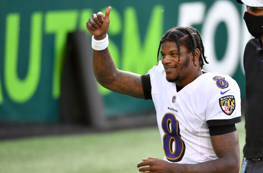 Oct 18, 2020; Philadelphia, Pennsylvania, USA; Baltimore Ravens quarterback Lamar Jackson (8) gives a thumbs up to Ravens fans as he runs off the field after win against the Philadelphia Eagles at Lincoln Financial Field. Mandatory Credit: Eric Hartline-USA TODAY Sports