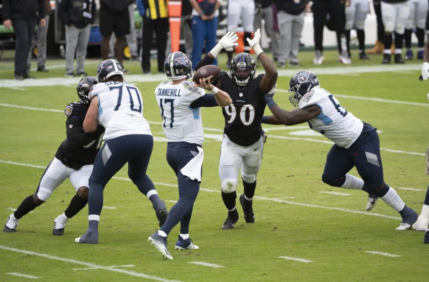 Nov 22, 2020; Baltimore, Maryland, USA; Baltimore Ravens outside linebacker Pernell McPhee (90) rushes as Tennessee Titans quarterback Ryan Tannehill (17) throws during the first half at M&T Bank Stadium. Mandatory Credit: Tommy Gilligan-USA TODAY Sports