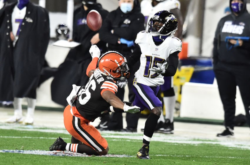 Dec 14, 2020; Cleveland, Ohio, USA; Cleveland Browns cornerback M.J. Stewart (36) defends against Baltimore Ravens wide receiver Marquise Brown (15) on a pass play during the first quarter at FirstEnergy Stadium. Stewart was called for pass interference. Mandatory Credit: Ken Blaze-USA TODAY Sports