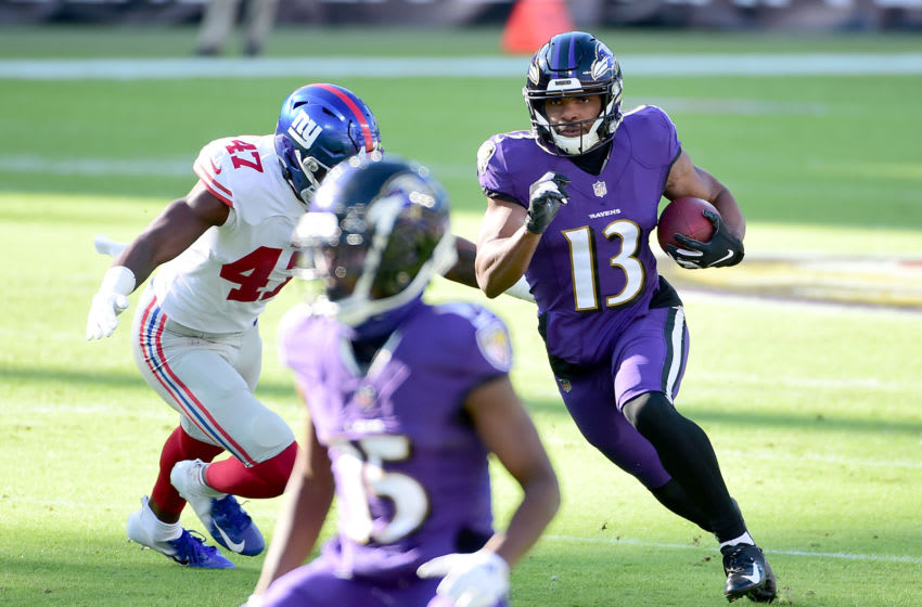 Dec 27, 2020; Baltimore, Maryland, USA; Baltimore Ravens wide receiver Devin Duvernay (13) runs with the ball while being pursued by New York Giants linebacker Cam Brown (47) in the first quarter at M&T Bank Stadium. Mandatory Credit: Evan Habeeb-USA TODAY Sports