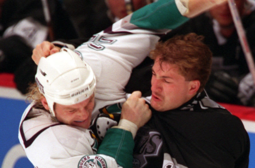 SP.Ducks.Fight.RDL (kodak) (left) Ken Baumgartner (22) of the Might Ducks (left) and Brad Smyth (11) of the Kings fight during their game at the Arrowhead Pond of Anaheim. TIMES (Photo by Robert Lachman/Los Angeles Times via Getty Images)