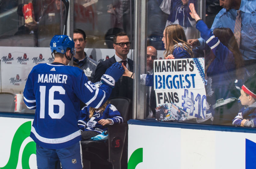 TORONTO, ON - JANUARY 7: Mitchell Marner #16 of the Toronto Maple Leafs greets a fan after warm up before playin against the Nashville Predators at the Scotiabank Arena on January 7, 2019 in Toronto, Ontario, Canada. (Photo by Kevin Sousa/NHLI via Getty Images)