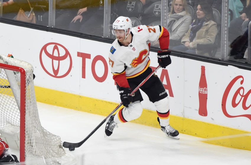 LOS ANGELES, CA - MARCH 26: Dougie Hamilton #27 of the Calgary Flames handles the puck during a game against the Los Angeles Kings at STAPLES Center on March 26, 2018 in Los Angeles, California. (Photo by Adam Pantozzi/NHLI via Getty Images)