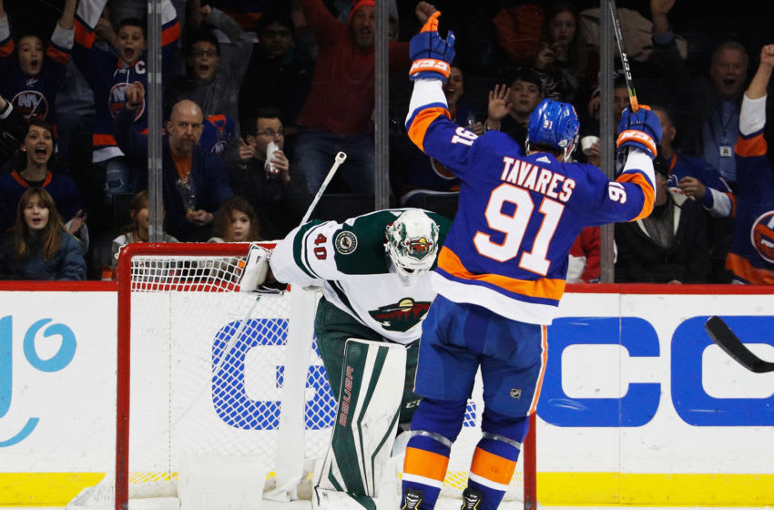 NEW YORK, NY - FEBRUARY 19: John Tavares #91 of the New York Islanders celebrates a second-period goal by teammate Anders Lee #27 (not pictured) against Devan Dubnyk #40 of the Minnesota Wild at Barclays Center on February 19, 2018 in the Brooklyn borough of New York City. (Photo by Paul Bereswill/NHLI via Getty Images)