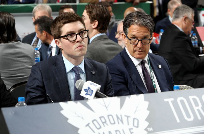 DALLAS, TX - JUNE 23: (l-r) Kyle Dubas and Brendan Shanahan of the Toronto Maple Leafs handle the draft table during the 2018 NHL Draft at American Airlines Center on June 23, 2018 in Dallas, Texas. (Photo by Bruce Bennett/Getty Images)