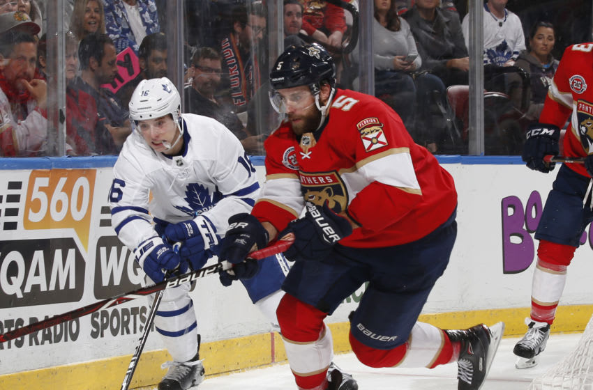 SUNRISE, FL - DECEMBER 15: Aaron Ekblad #5 of the Florida Panthers and Mitch Marner #16 of the Toronto Maple Leafs battle behind the net during second period action at the BB&T Center on December 15, 2018 in Sunrise, Florida. (Photo by Joel Auerbach/Getty Images)