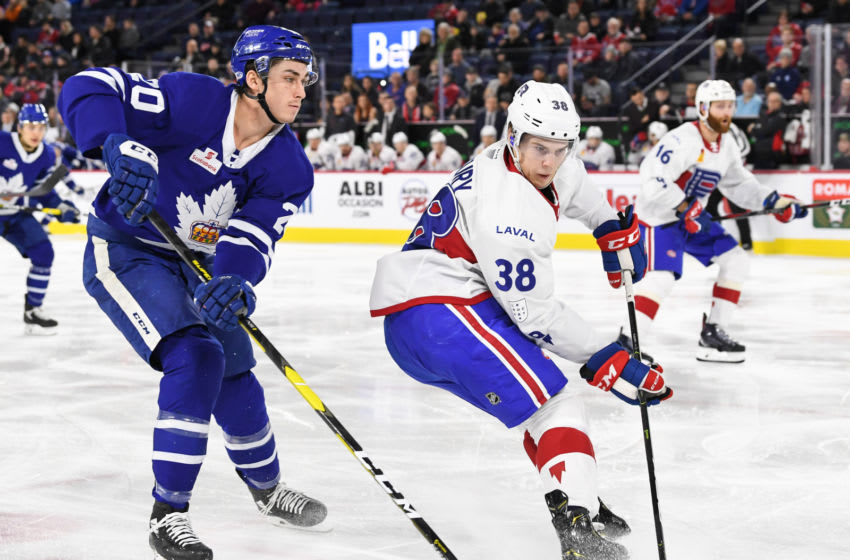 LAVAL, QC - DECEMBER 22: Cale Fleury #38 of the Laval Rocket skates against Mason Marchment #20 of the Toronto Marlies during the AHL game at Place Bell on December 22, 2018 in Laval, Quebec, Canada. The Toronto Marlies defeated the Laval Rocket 2-0. (Photo by Minas Panagiotakis/Getty Images)