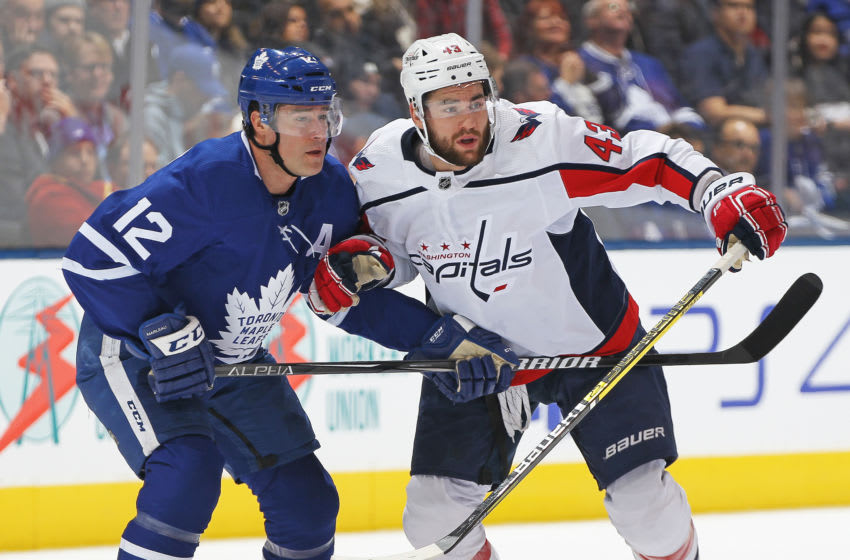 TORONTO, ON - JANUARY 23: Tom Wilson #43 of the Washington Capitals skates against Patrick Marleau #12 of the Toronto Maple Leafs during an NHL game at Scotiabank Arena on January 23, 2019 in Toronto, Ontario, Canada. The Maple Leafs defeated the Capitals 6-3. (Photo by Claus Andersen/Getty Images)