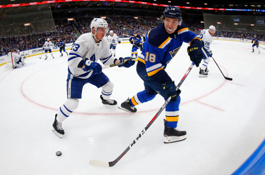 ST. LOUIS, MO - FEBRUARY 19: Robert Thomas #18 of the St. Louis Blues passes the puck against Travis Dermott #23 of the Toronto Maple Leafs at the Enterprise Center on February 19, 2019 in St. Louis, Missouri. (Photo by Dilip Vishwanat/Getty Images)