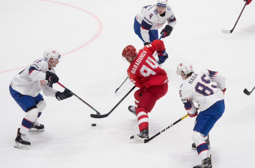 Russias forward Alexander Barabanov (C) vies with Norway's defender Johannes Johannesen (top), Norway's forward Michael Haga (R) and Norway's defender Stefan Espeland (L) during the IIHF Men's Ice Hockey World Championships Group B match between Russia and Norway on May 10, 2019 in Bratislava. (Photo by VLADIMIR SIMICEK / AFP) (Photo credit should read VLADIMIR SIMICEK/AFP via Getty Images)