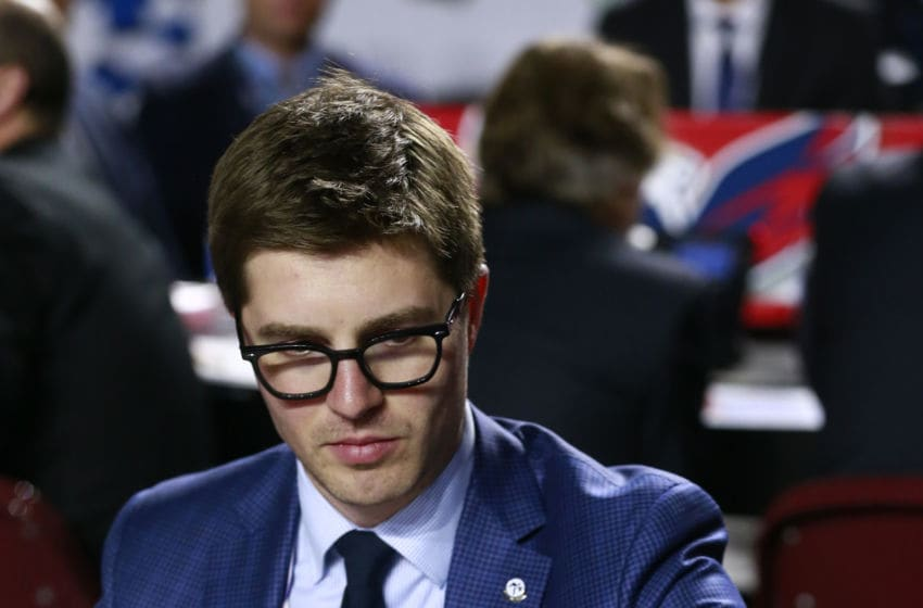 VANCOUVER, BRITISH COLUMBIA - JUNE 21: General manager Kyle Dubas of the Toronto Maple Leafs puts the phone down during the first round of the 2019 NHL Draft at Rogers Arena on June 21, 2019 in Vancouver, Canada. (Photo by Jeff Vinnick/NHLI via Getty Images)