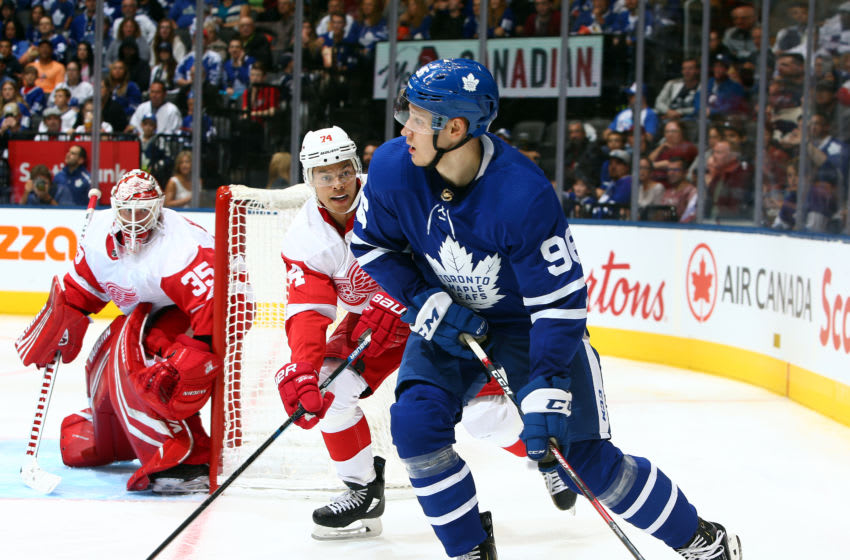 TORONTO, ON - SEPTEMBER 28: Yegor Korshkov #96 of the Toronto Maple Leafs passes the puck away as Madison Bowey #74 of the Detroit Red Wings defends during an NHL pre-season game at Scotiabank Arena on September 28, 2019 in Toronto, Canada. (Photo by Vaughn Ridley/Getty Images)