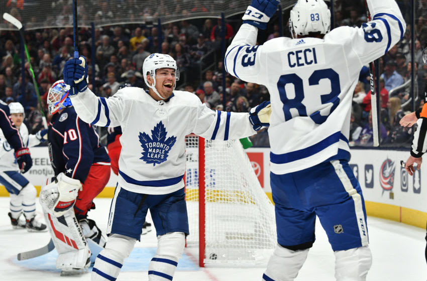 COLUMBUS, OH - OCTOBER 4: Andreas Johnsson #18 of the Toronto Maple Leafs reacts after Cody Ceci #83 of the Toronto Maple Leafs scores a goal during the second period in a game against the Columbus Blue Jackets on October 4, 2019 at Nationwide Arena in Columbus, Ohio. (Photo by Jamie Sabau/NHLI via Getty Images)