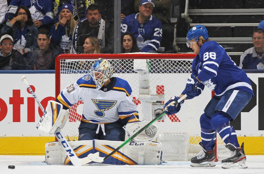 TORONTO, ON - OCTOBER 7: William Nylander #88 of the Toronto Maple Leafs looks to tip a puck at Jordan Binnington #50 of the St. Louis Blues during an NHL game at Scotiabank Arena on October 7, 2019 in Toronto, Ontario, Canada. The Blues defeated the Maple Leafs 3-2. (Photo by Claus Andersen/Getty Images)