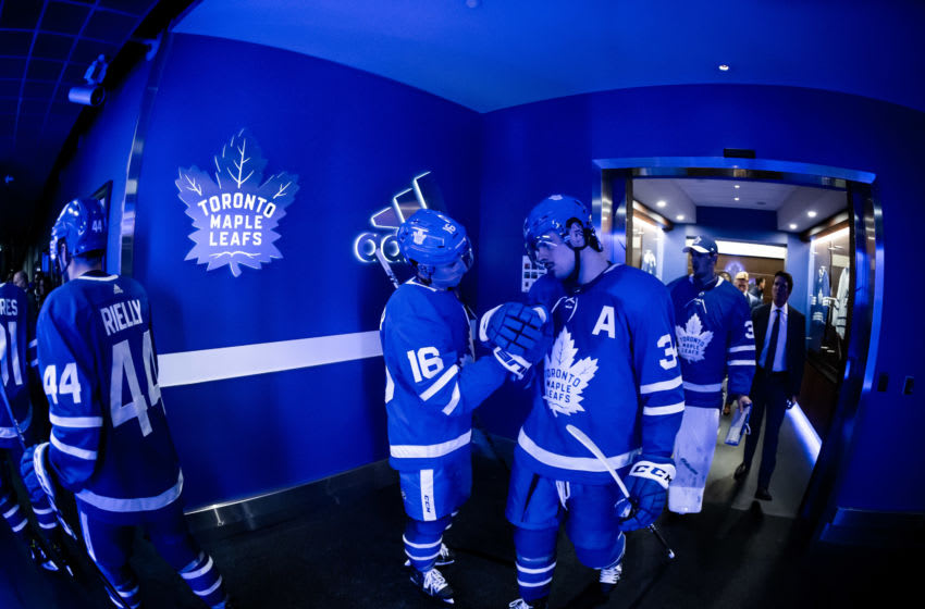 TORONTO, ON - OCTOBER 7: Toronto Maple Leafs center Mitchell Marner #16 center Auston Matthews #34 a high five before playing the St. Louis Blues period at the Scotiabank Arena on October 7, 2019 in Toronto, Ontario, Canada. (Photo by Kevin Sousa/NHLI via Getty Images)