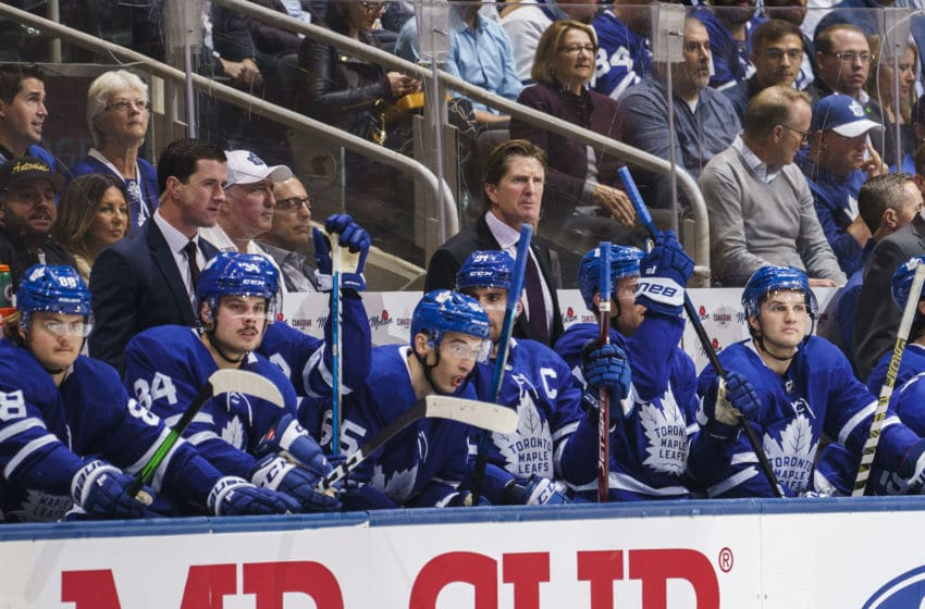 TORONTO, ON - OCTOBER 10: Mike Babcock head coach of the Toronto Maple Leafs watches on against the Tampa Bay Lightning during the first period at the Scotiabank Arena on October 10, 2019 in Toronto, Ontario, Canada. (Photo by Mark Blinch/NHLI via Getty Images)