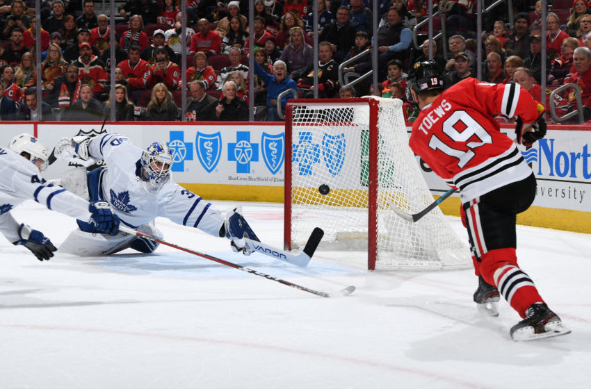 CHICAGO, IL - NOVEMBER 10: Jonathan Toews #19 of the Chicago Blackhawks scores on goalie Michael Hutchinson #30 of the Toronto Maple Leafs in the first period at the United Center on November 10, 2019 in Chicago, Illinois. (Photo by Bill Smith/NHLI via Getty Images)