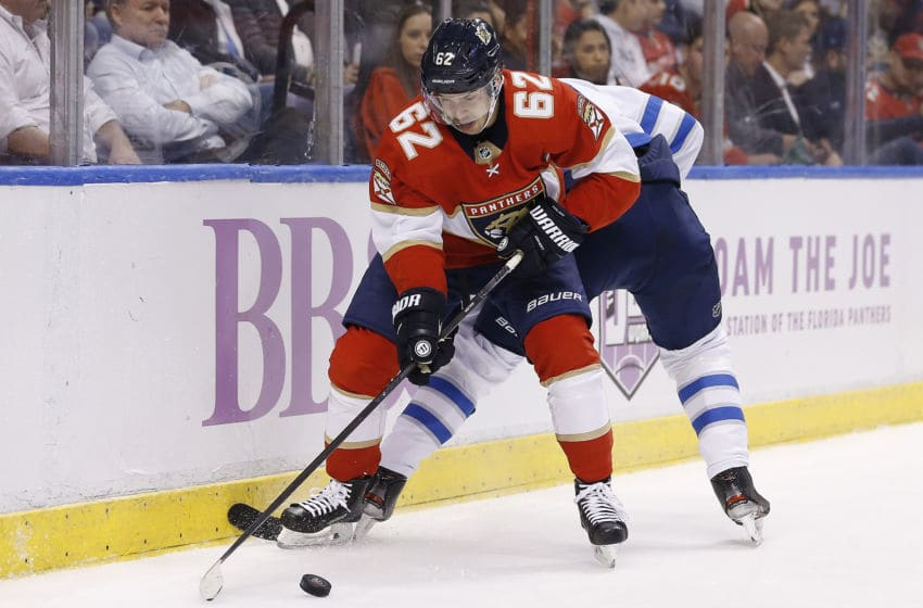 SUNRISE, FLORIDA - NOVEMBER 14: Denis Malgin #62 of the Florida Panthers battles for the puck against the Winnipeg Jets during the second period at BB&T Center on November 14, 2019 in Sunrise, Florida. (Photo by Michael Reaves/Getty Images)