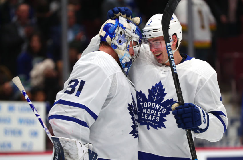 VANCOUVER, BC - DECEMBER 10: Toronto Maple Leafs Defenceman Justin Holl (3) congratulates teammate Goalie Frederik Andersen (31) after defeating the Vancouver Canucks 4-1 during their NHL game at Rogers Arena on December 10, 2019 in Vancouver, British Columbia, Canada. (Photo by Devin Manky/Icon Sportswire via Getty Images)