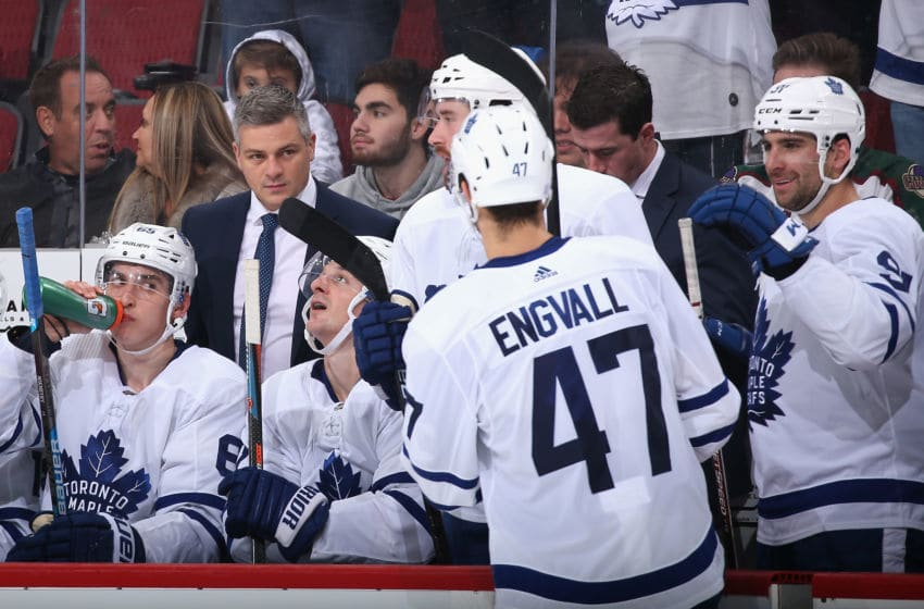 GLENDALE, ARIZONA - NOVEMBER 21: Pierre Engvall #47 of the Toronto Maple Leafs is congratulated by head coach Sheldon Keefe after scoring a short handed goal against the Arizona Coyotes during the second period of the NHL game at Gila River Arena on November 21, 2019 in Glendale, Arizona. (Photo by Christian Petersen/Getty Images)