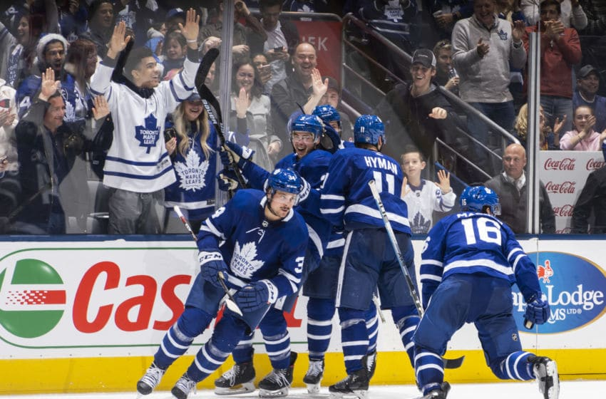 TORONTO, ON - DECEMBER 23: Mitch Marner #16 of the Toronto Maple Leafs celebrates his goal against the Carolina Hurricanes with teammates Auston Matthews #34, Justin Holl #3, Zach Hyman #11 and Jake Muzzin #8 during the third period at the Scotiabank Arena on December 23, 2019 in Toronto, Ontario, Canada. (Photo by Mark Blinch/NHLI via Getty Images)