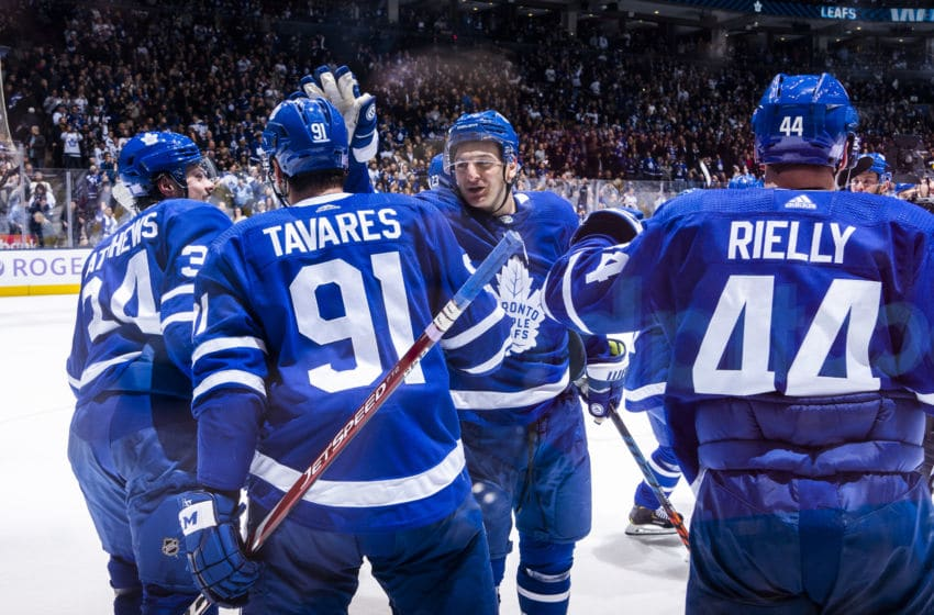 TORONTO, ON - NOVEMBER 30: John Tavares #91 of the Toronto Maple Leafs is congratulated by teammate Zach Hyman #11 after scoring the over time winner against the Buffalo Sabres at the Scotiabank Arena on November 30, 2019 in Toronto, Ontario, Canada. (Photo by Mark Blinch/NHLI via Getty Images)