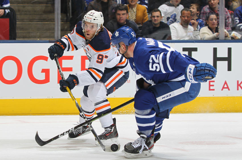 TORONTO, ON - JANUARY 06: Connor McDavid #97 of the Edmonton Oilers fires a shot against Martin Marincin #52 of the Toronto Maple Leafs during an NHL game at Scotiabank Arena on January 6, 2020 in Toronto, Ontario, Canada. (Photo by Claus Andersen/Getty Images)