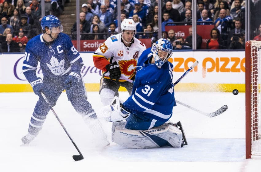 TORONTO, ON - JANUARY 16: Frederik Andersen #31 of the Toronto Maple Leafs watches as the puck goes wide of the net against the Calgary Flames in overtime at the Scotiabank Arena on January 16, 2020 in Toronto, Ontario, Canada. (Photo by Kevin Sousa/NHLI via Getty Images)
