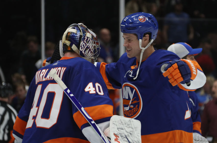 UNIONDALE, NEW YORK - JANUARY 06: Semyon Varlamov #40 of the New York Islanders celebrates his 1-0 shut-out against his former team the Colorado Avalanche and is joined by Matt Martin #17 at NYCB Live's Nassau Coliseum on January 06, 2020 in Uniondale, New York. (Photo by Bruce Bennett/Getty Images)