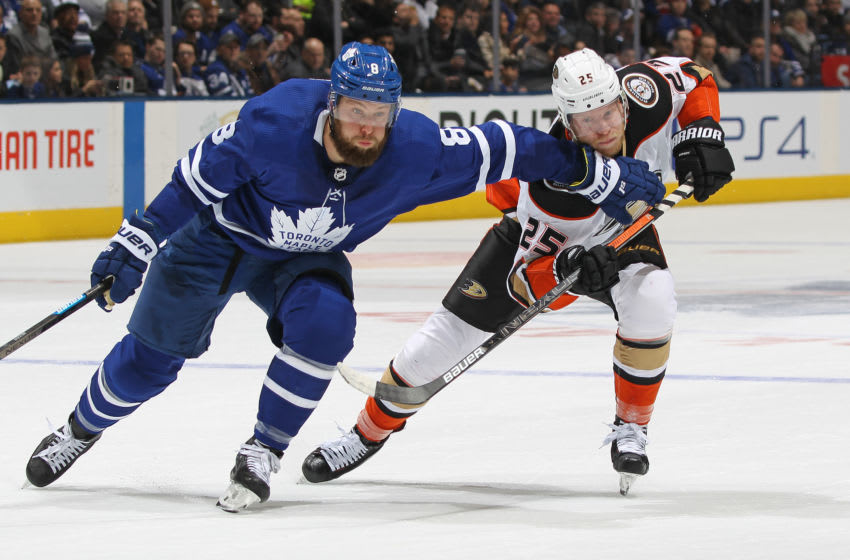 TORONTO, ON - FEBRUARY 7: Ondrej Kase #25 of the Anaheim Ducks battles against Jake Muzzin #8 of the Toronto Maple Leafs during an NHL game at Scotiabank Arena on February 7, 2020 in Toronto, Ontario, Canada. (Photo by Claus Andersen/Getty Images)