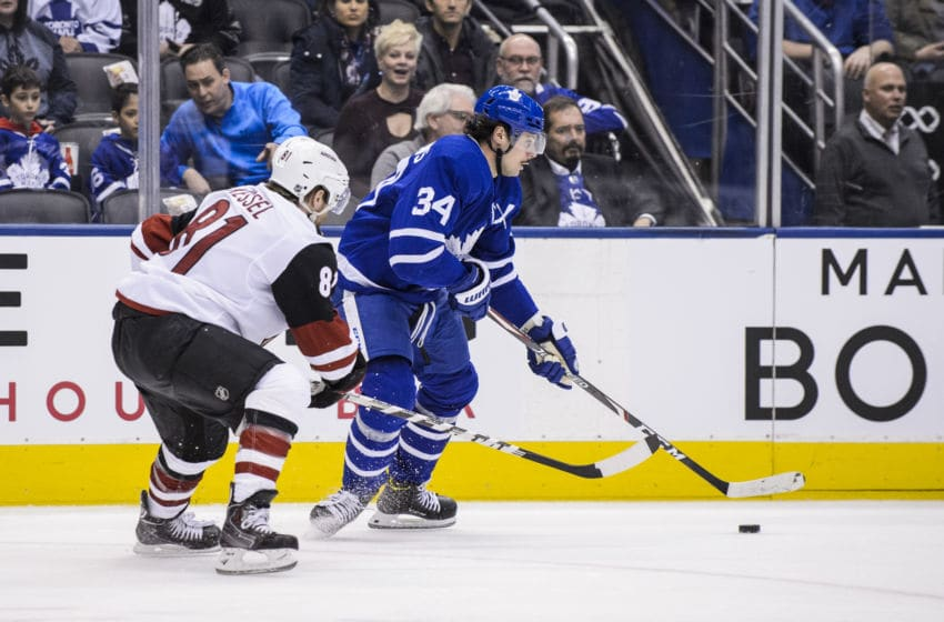 TORONTO, ON - FEBRUARY 11: Auston Matthews #34 of the Toronto Maple Leafs plays the puck against Phil Kessel #81 of the Arizona Coyotes during the first period at the Scotiabank Arena on February 11, 2020 in Toronto, Ontario, Canada. (Photo by Andrew Lahodynskyj/NHLI via Getty Images)