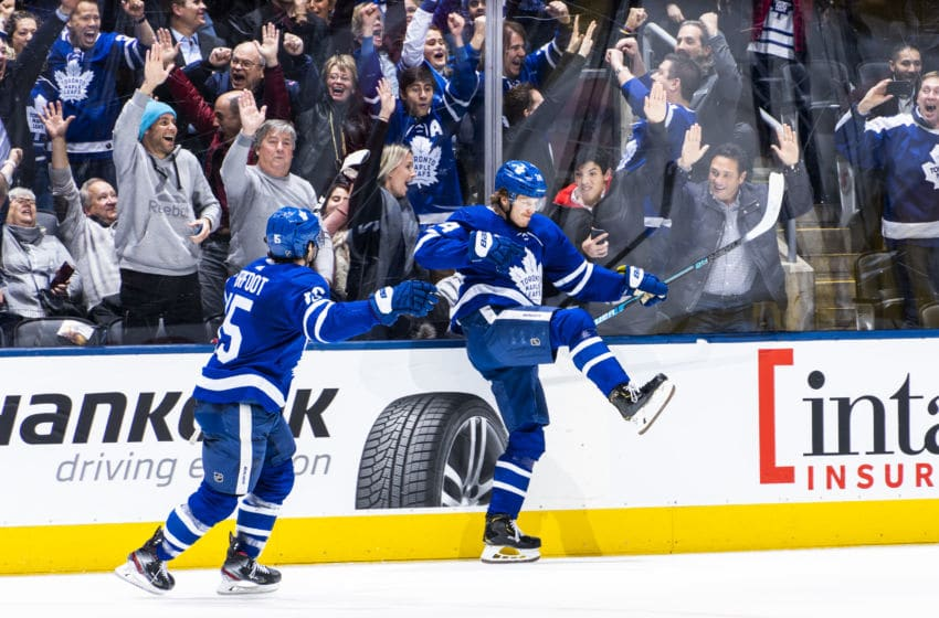 TORONTO, ON - FEBRUARY 11: Kasperi Kapanen #24 of the Toronto Maple Leafs celebrates his game winning goal against the Arizona Coyotes with teammate Alexander Kerfoot #15 in overtime at the Scotiabank Arena on February 11, 2020 in Toronto, Ontario, Canada. (Photo by Mark Blinch/NHLI via Getty Images)