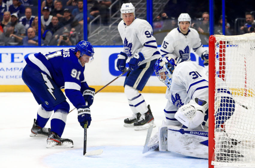 TAMPA, FLORIDA - FEBRUARY 25: Steven Stamkos #91 of the Tampa Bay Lightning and Frederik Andersen #31 of the Toronto Maple Leafs fight for the puck during a game at Amalie Arena on February 25, 2020 in Tampa, Florida. (Photo by Mike Ehrmann/Getty Images)