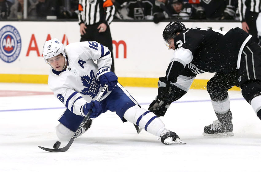 LOS ANGELES, CALIFORNIA - MARCH 05: Mitchell Marner #16 of the Toronto Maple Leafs takes a slapshot against Dustin Brown #23 of the Los Angeles Kings during the third period at Staples Center on March 05, 2020 in Los Angeles, California. (Photo by Katelyn Mulcahy/Getty Images)