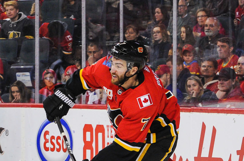 CALGARY, AB - MARCH 8: T.J. Brodie #7 of the Calgary Flames in action against the Vegas Golden Knights during an NHL game at Scotiabank Saddledome on March 8, 2020 in Calgary, Alberta, Canada. (Photo by Derek Leung/Getty Images)