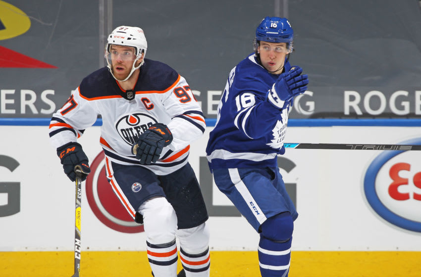 TORONTO,ON - JANUARY 22: Connor McDavid #97 of the Edmonton Oilers skates against Mitchell Marner #16 of the Toronto Maple Leafs during an NHL game at Scotiabank Arena on January 22, 2021 in Toronto, Ontario, Canada. The Maple Leafs defeated the Oilers 4-2. (Photo by Claus Andersen/Getty Images)