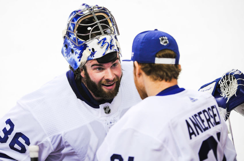 CALGARY, AB - JANUARY 24:Jack Campbell #36 and Frederik Andersen #31 of the Toronto Maple Leafs confer during a break in play against the Calgary Flames during an NHL game at Scotiabank Saddledome on January 24, 2021 in Calgary, Alberta, Canada. (Photo by Derek Leung/Getty Images)