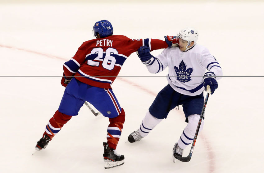 TORONTO, ONTARIO - JULY 28: Jeff Petry #26 of the Montreal Canadiens and Zach Hyman #11 of the Toronto Maple Leafs fight for position in the second period during an exhibition game prior to the 2020 NHL Stanley Cup Playoffs at Scotiabank Arena on July 28, 2020 in Toronto, Ontario. (Photo by Andre Ringuette/Freestyle Photo/Getty Images)