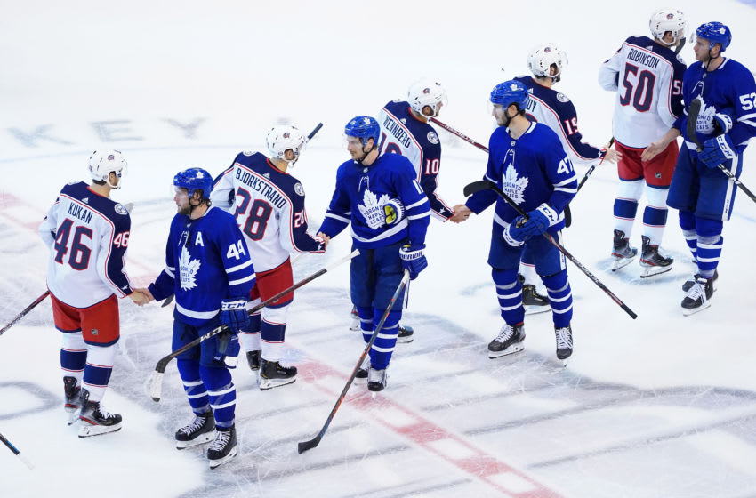 TORONTO, ONTARIO - AUGUST 09: Columbus Blue Jackets shake hands with the Toronto Maple Leafs after winning 3-0 in Game Five of the Eastern Conference Qualification Round prior to the 2020 NHL Stanley Cup Playoffs at Scotiabank Arena on August 09, 2020 in Toronto, Ontario. (Photo by Andre Ringuette/Freestyle Photo/Getty Images)