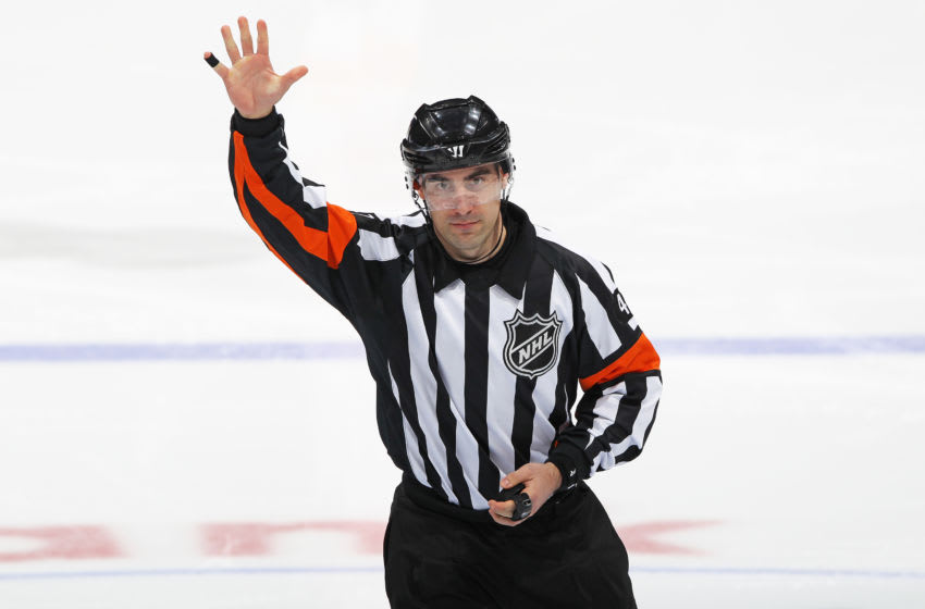 Referee Michael Markovic #47 calls play between the Toronto Maple Leafs and Calgary Flames. (Photo by Claus Andersen/Getty Images)