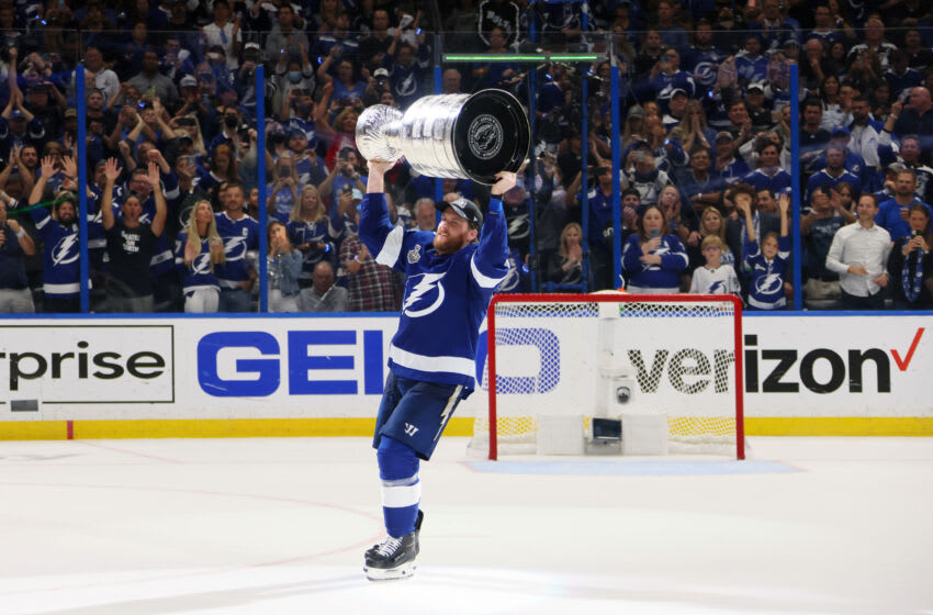 TAMPA, FLORIDA - JULY 07: Blake Coleman #20 of the Tampa Bay Lightning celebrates with the Stanley Cup after the 1-0 victory against the Montreal Canadiens in Game Five to win the 2021 NHL Stanley Cup Final at Amalie Arena on July 07, 2021 in Tampa, Florida. (Photo by Bruce Bennett/Getty Images)