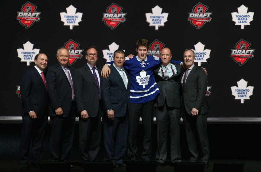 NEWARK, NJ - JUNE 30: Frederik Gauthier poses with the front office after being selected number twenty one overall in the first round by the Toronto Maple Leafs during the 2013 NHL Draft at the Prudential Center on June 30, 2013 in Newark, New Jersey. (Photo by Bruce Bennett/Getty Images)